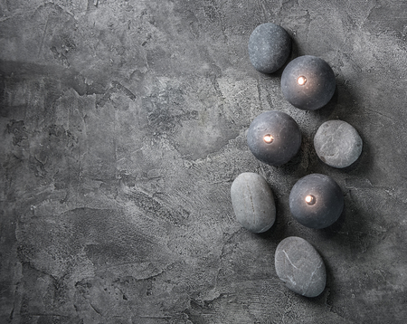 Wax candles and massage stones, top view Stock Photo