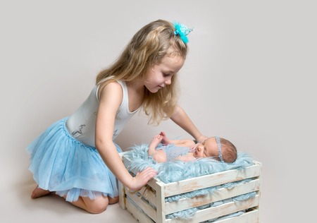 Little girl and her newborn sister