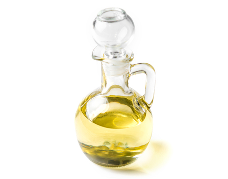 Small glass jar of natural extra virgin olive oil isolated on white background Stock Photo