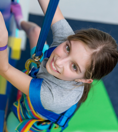 Portrait of teen girl on the climbing wall 스톡 콘텐츠 - 95214323