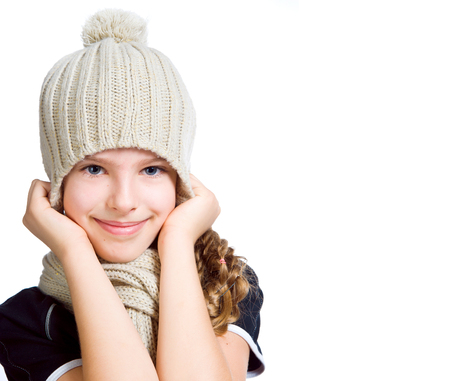 little girl in cap and scarf