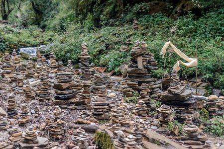 Pyramid of stones on Annapurna Sanctuary trek in Nepal Stock Photo
