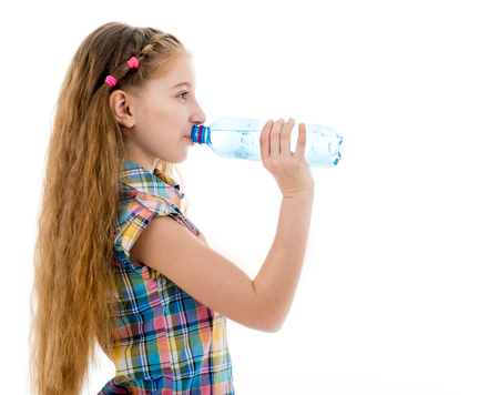 Girl drinking mineral water from bottle Фото со стока