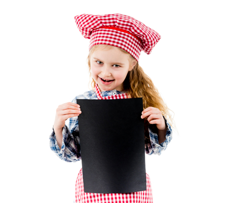 Little girl in chef uniform with blank paper