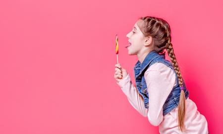 Cute teen girl with candy lollipop Foto de archivo