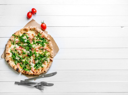 Italian pizza on white wooden background Stock Photo