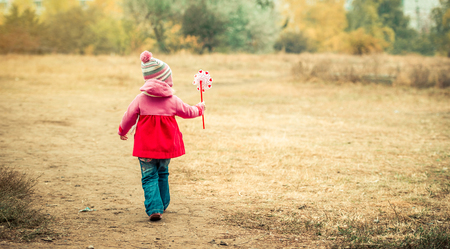 Little girl walking with windmill