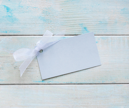 Paper greeting card on wooden background