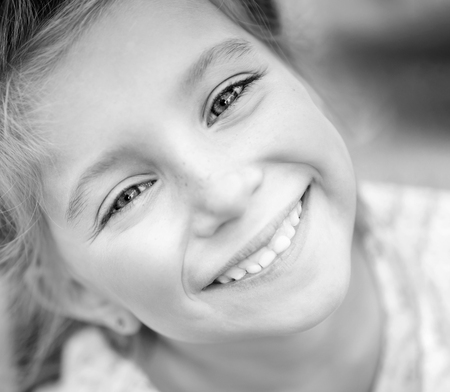 Cute little girl in black and white, close up Banco de Imagens
