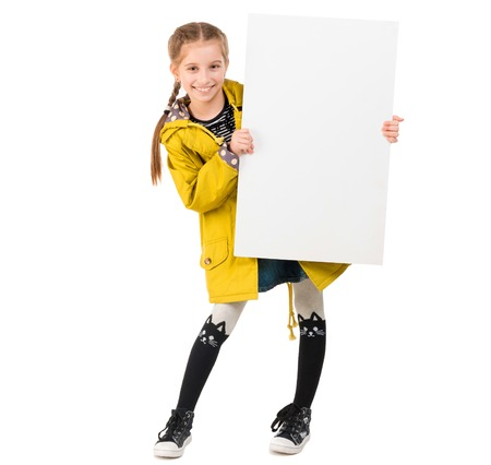 smiling little girl with blank sheet in hands