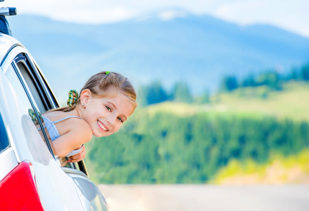 portrait of a little girl in the car 写真素材