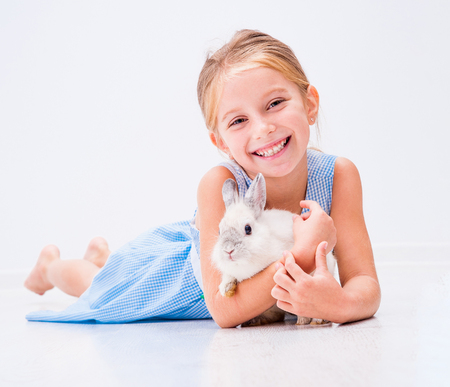 cute little girl a white rabbit