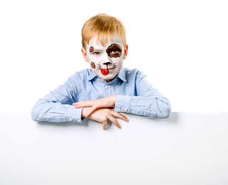 Boy with face painting like a dog