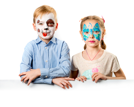 Children with bright creative face paintings Banco de Imagens