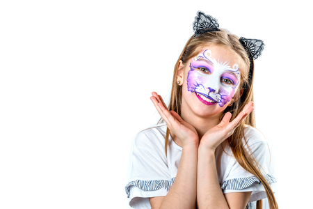 Portrait of teen girl with cat face painting Stock Photo