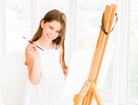 Pretty girl with brush in hand Stockfoto