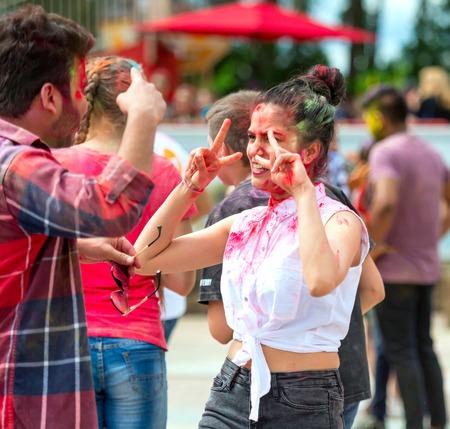 People celebrating Holi color festival in Kharkiv, Ukraine. Stock Photo - 106523377