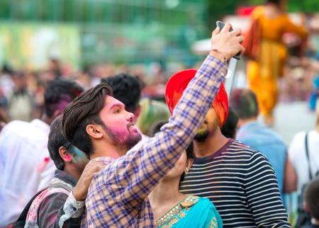 People celebrating Holi color festival in Kharkiv, Ukraine.