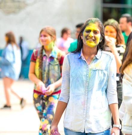 People celebrating Holi color festival in Kharkiv, Ukraine. Stock Photo - 106523410