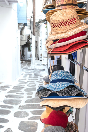 Straw summer hats on market stall outdoor Stock Photo