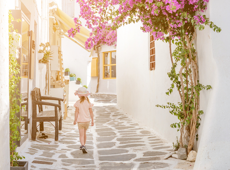 Little girl walking the narrow alley in Greece
