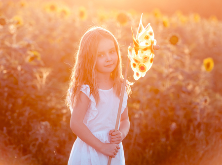 cute little girl with a windmill Stock Photo