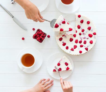 Children eating panna cotta with raspberry