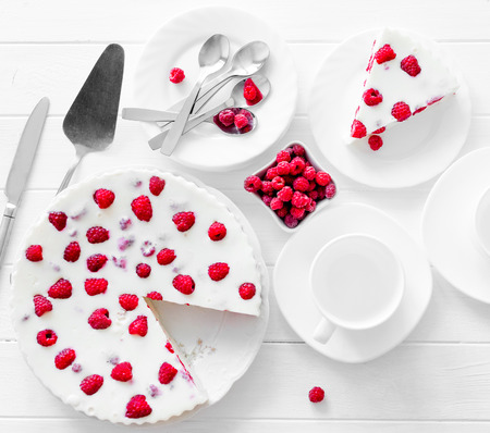 Panna cotta raspberries on a wooden table Stock Photo