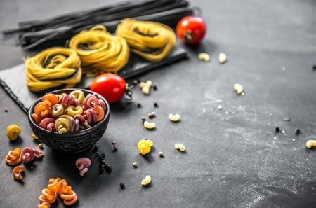 Still life of Italian pasta on grey stone background
