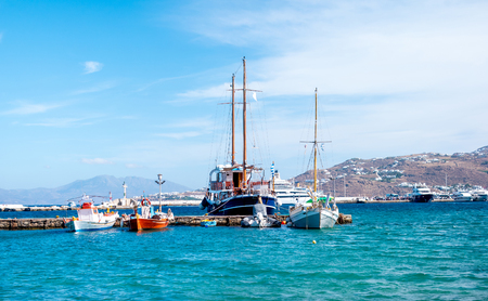 Icredible view of sailing yachts and boats and mountanious landscape of greece island