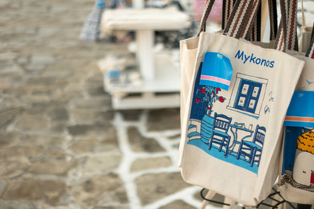 Tote bag souvenir for sale on street market, Greece