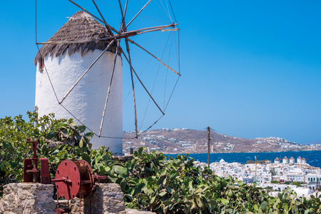 White typical greek windmill on the hill