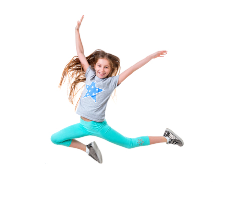 long-haired active girl dancing, isolated