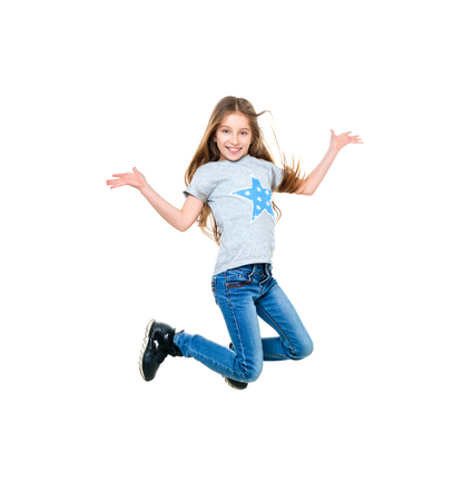 preteen girl dancing and jumping, isolated