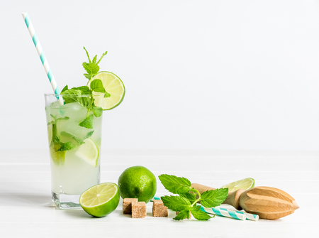 Non-alcoholic cocktail mojito with ingredients for its preparation