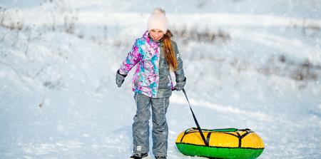 Little girl goes for winter slide