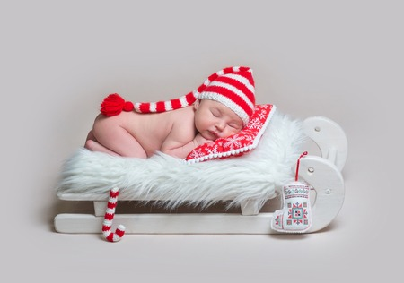 Infant baby sleeping on wooden crib