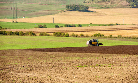 Tractor plowing the field Stok Fotoğraf - 111294973