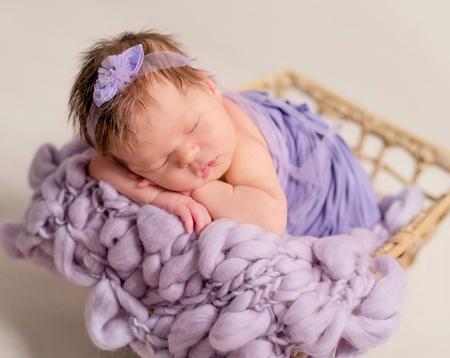 Cute little baby sleeping in the basket