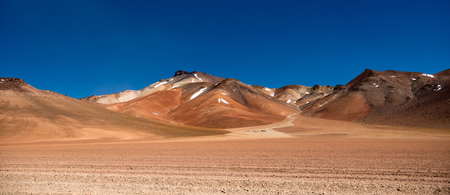 Panoramic view of wide sunshine mountanious Bolivian desert Stock Photo
