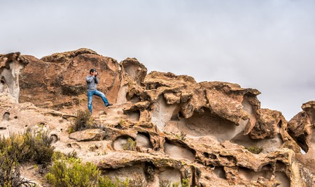 Scenery of rocky mountanious Bolivian landscape and photographer 写真素材