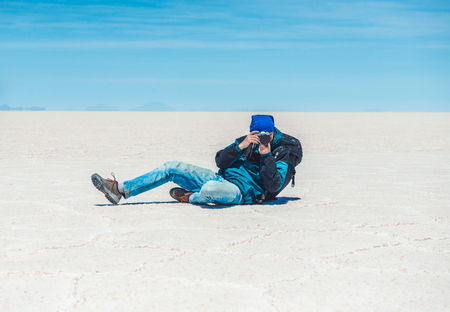 Photographer take photo in Salar de Uyuni Banco de Imagens