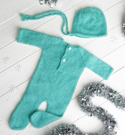 Green knitted clothes for babies