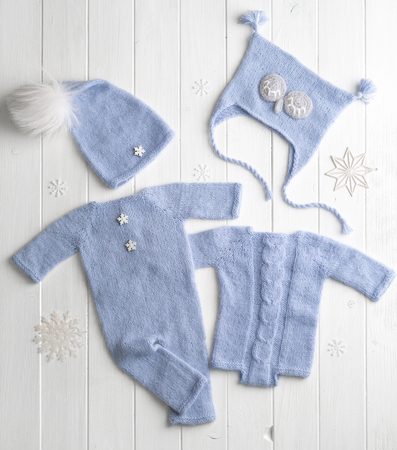 Blue knitted clothes for babies