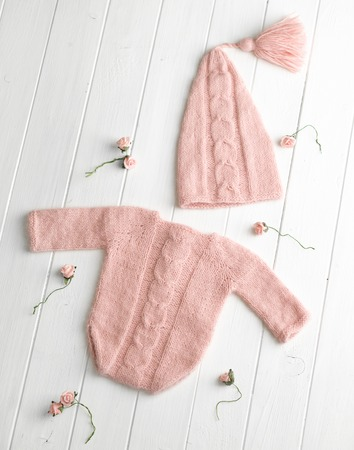 Pink knitted clothes for babies Stock Photo