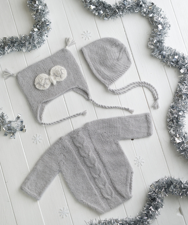 Grey knitted clothes for babies Stock Photo - 115187943