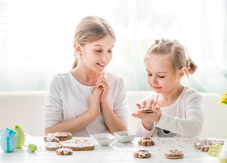 Girls decorating homemade gingerbread cookies