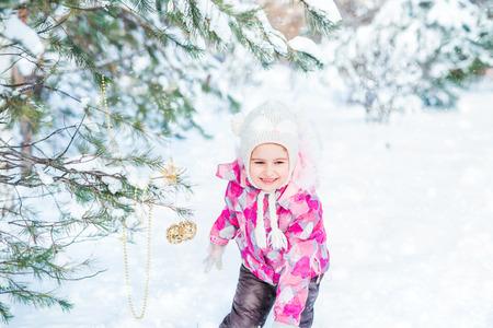Smiling teenage girl wobble of snow