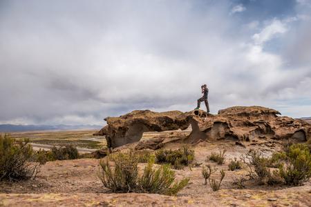 Scenery of rocky mountanious Bolivian landscape and photographer Archivio Fotografico - 116001729