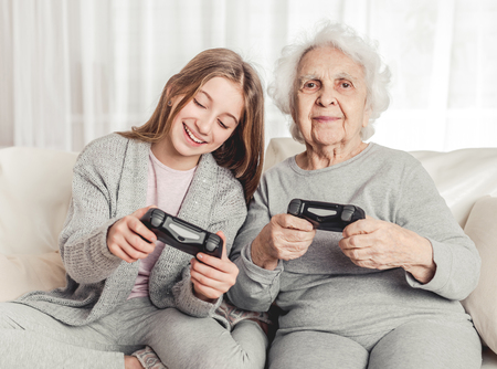 Grandmother with granddaughter playing games
